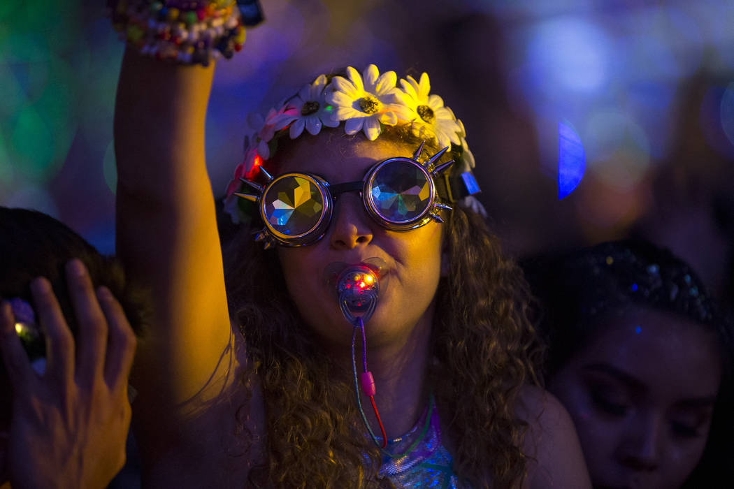 Festivalgoers dance to the sounds of American DJ Kaskade on day one of the Electric Daisy Carnival at the Las Vegas Motor Speedway on Saturday, May 19, 2018. Richard Brian Las Vegas Review-Journal ...