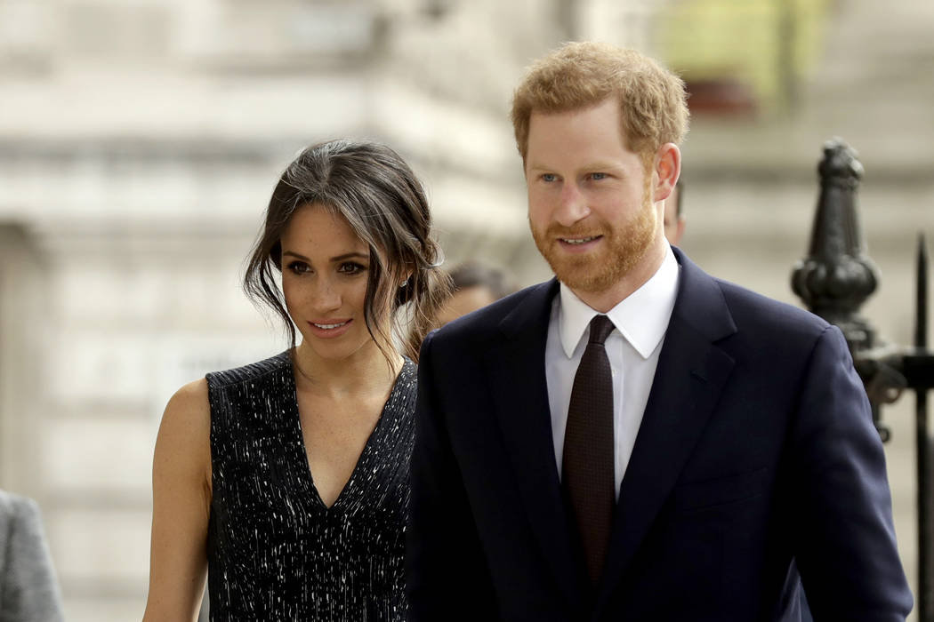 Britain's Prince Harry and his fiancee Meghan Markle will be married Saturday at Windsor Castle. (Matt Dunham/AP, file)