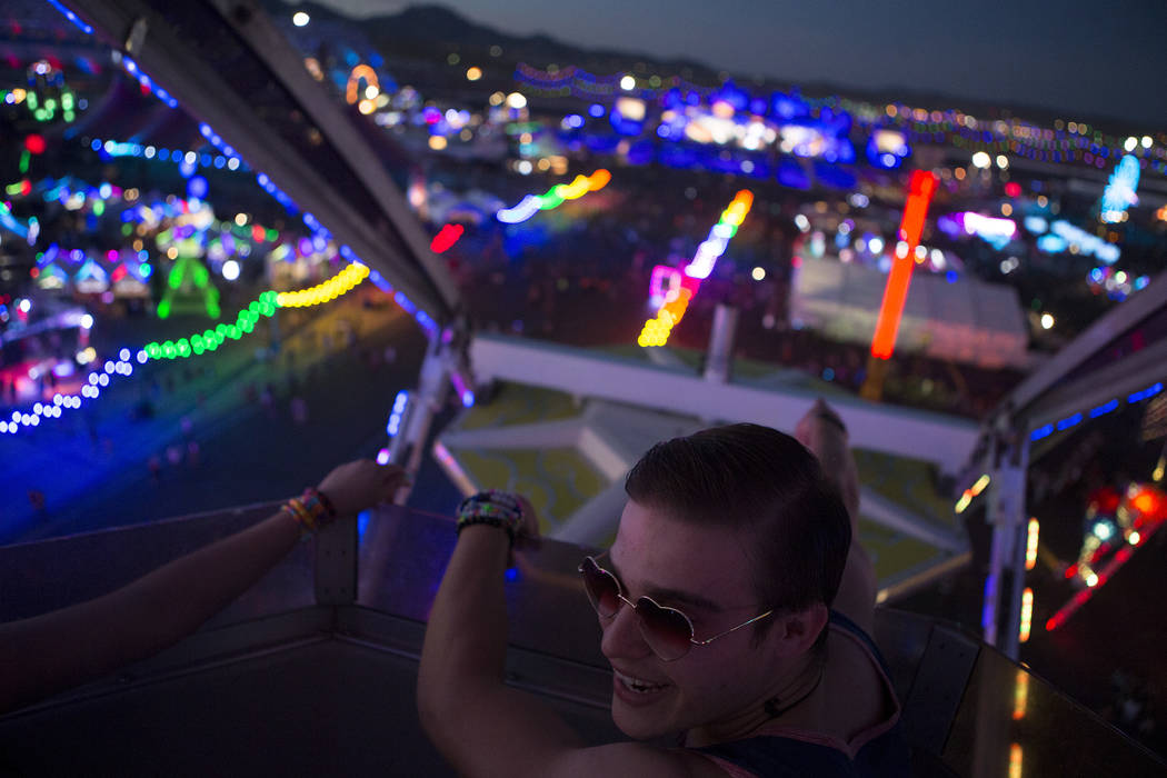 Luis Huerta from Los Angeles rides the Ferris wheel with friends on the second night of Electric Daisy Carnival at Las Vegas Motor Speedway on Saturday, June 17, 2017 in Las Vegas. Bridget Bennett ...