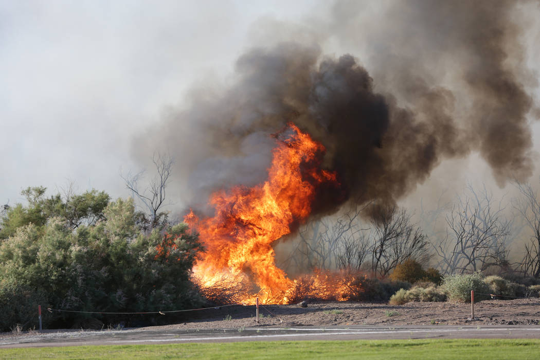 Wildfire engulfs brush near Sam Boyd Stadium and William Bennett Radio Controlled Airfield on the eastern edge of the Las Vegas Valley on Thursday, May 17, 2018. Michael Quine/Las Vegas Review-Jou ...