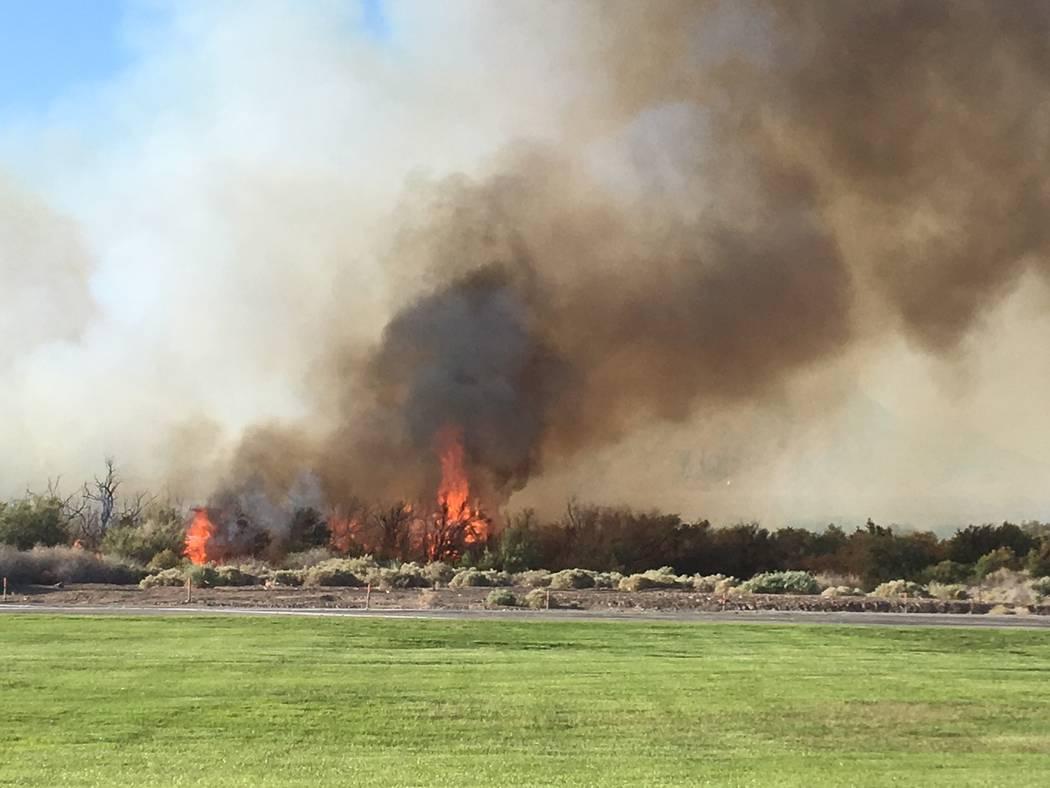 A fire burns near Clark County Wetlands Park and Sam Boyd Stadium on Thursday. (Michael Quine/Las Vegas Review-Journal)