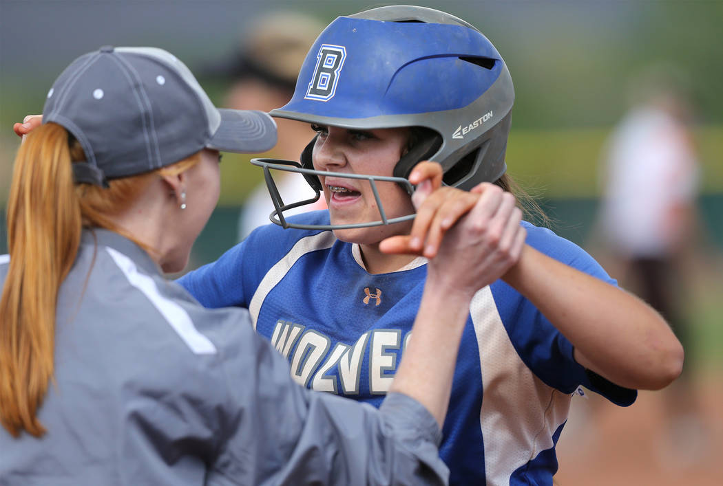 Basic Wolves' Mikayla Berg celebrates a hit in the bottom of the seventh inning against the Douglas Tigers during the NIAA 4A softball tournament, in Reno, Nev., on Thursday, May 17, 2018. Despite ...