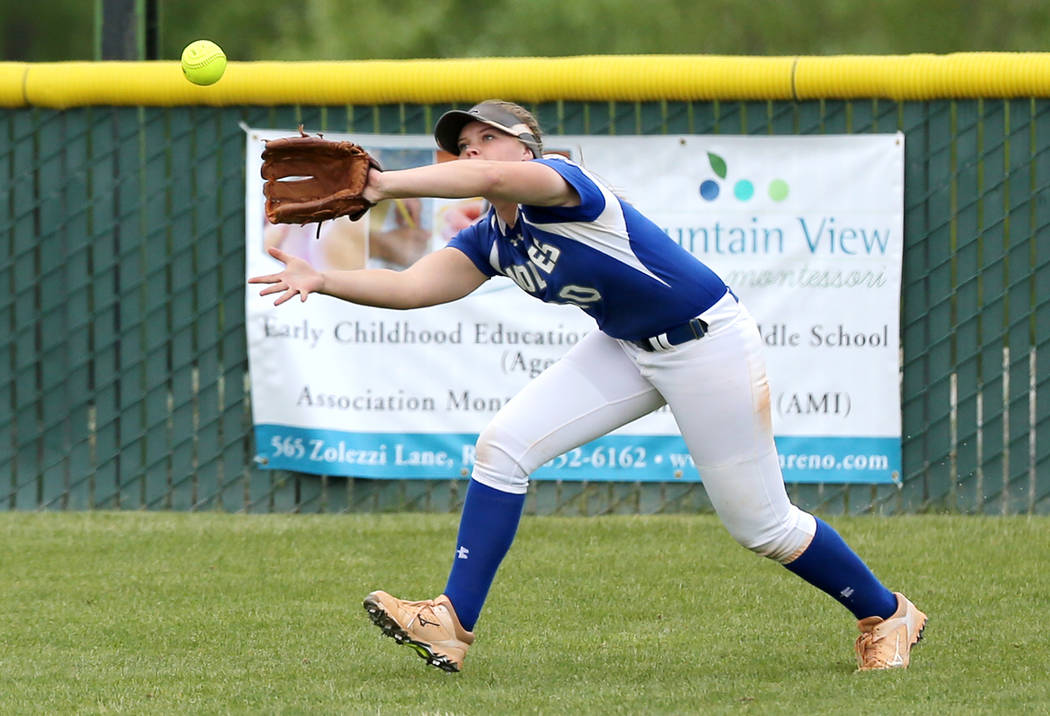 Basic Wolves' Jordan Stinnett makes a catch in left field against the Douglas Tigers in the NIAA 4A softball tournament, in Reno, Nev., on Thursday, May 17, 2018. Douglas won 8-5. Cathleen Allison ...