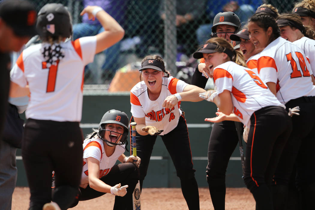 The Douglas Tigers greet Chloe Pratt at the plate after her home run against the Basic Wolves in first round action in the NIAA 4A softball tournament, in Reno, Nev., on Thursday, May 17, 2018. Do ...