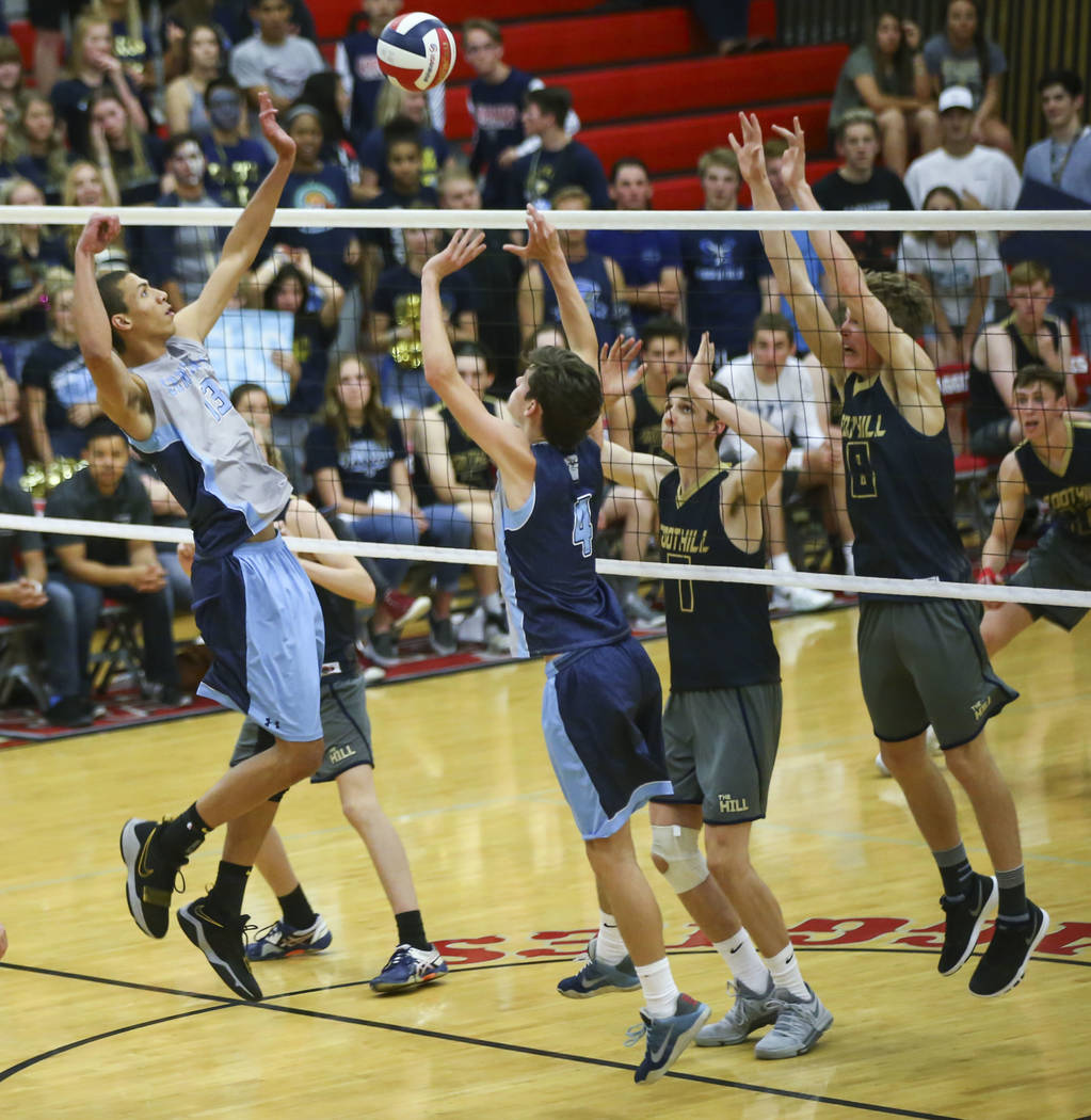 Centennial's Sam Durkin (4) sets the ball for Centennial's Teon Taylor (13) during the third set of the Class 4A state volleyball championship match against Foothill at Arbor View High School in L ...