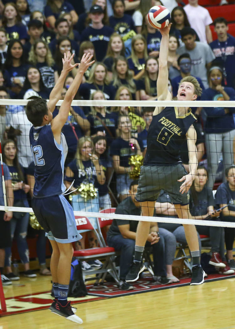 Foothill's Richard Reid (8) attacks as Centennial's Austin Anderson (12) defends during the first set of the Class 4A state volleyball championship match at Arbor View High School in Las Vegas on ...