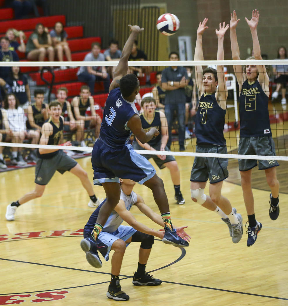 Centennial's Farries Gardner (3) sends the ball over the net as Foothill's Caden Thomas (7) and Brock Weaver (5) defend during the first set of the Class 4A state volleyball championship match at ...