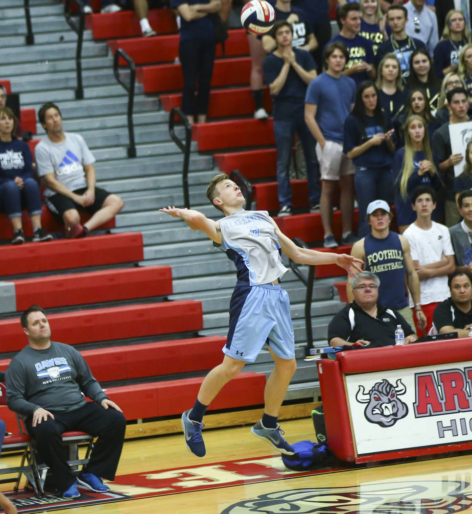 Centennial's Justin Madsen (6) goes up for the ball during the first set of the Class 4A state volleyball championship match against Foothill at Arbor View High School in Las Vegas on Thursday, Ma ...