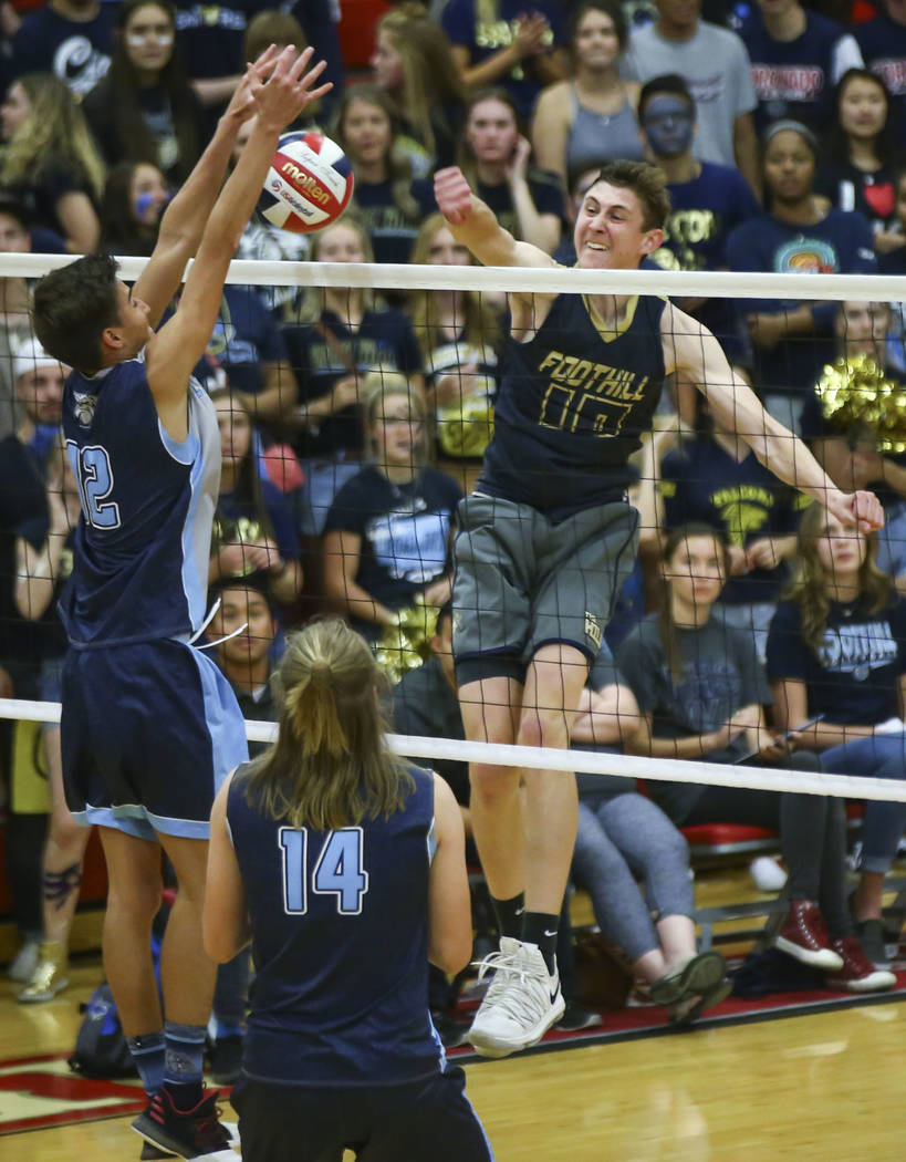 Centennial's Austin Anderson (12) blocks a shot from Foothill's Caleb Stearman (10) during the third set of the Class 4A state volleyball championship match at Arbor View High School in Las Vegas ...