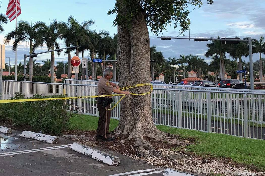 Police tape off an area by the Trump National Doral resort after reports of a shooting inside the resort Friday, May 18, 2018 in Doral, Fla. A man shouting about Donald Trump entered the presiden ...