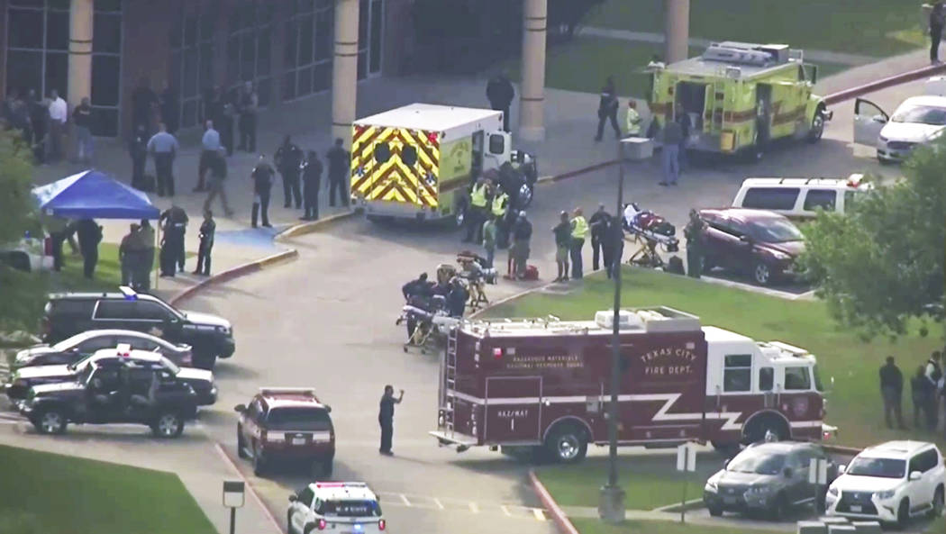 In this image taken from video emergency personnel and law enforcement officers respond to a high school near Houston after an active shooter was reported on campus, Friday, May 18, 2018, in Santa ...