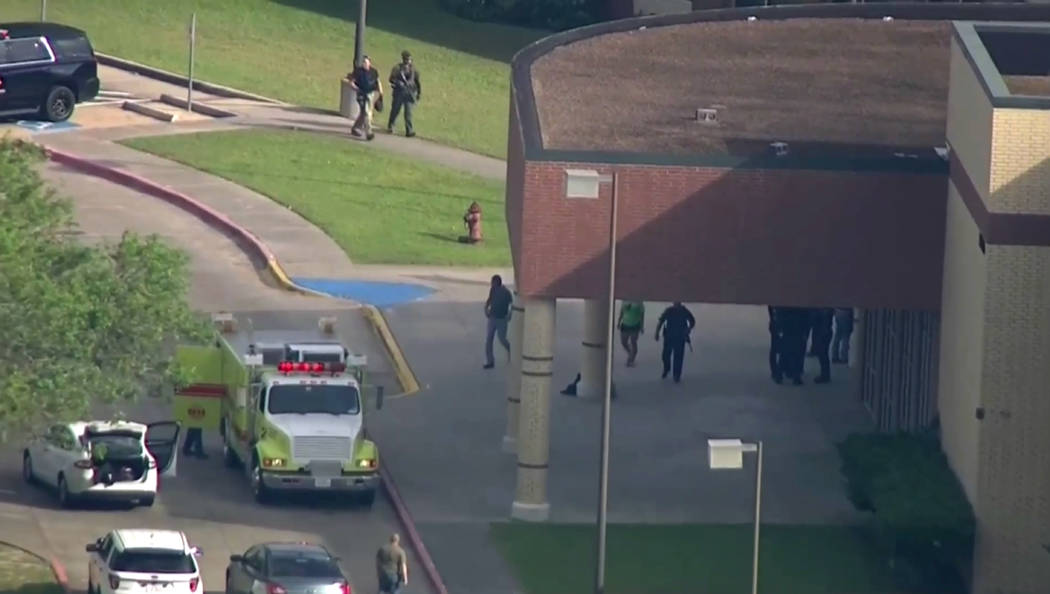 In this image taken from video law enforcement officers respond to a high school near Houston after an active shooter was reported on campus, Friday, May 18, 2018, in Santa Fe, Texas. The Santa Fe ...