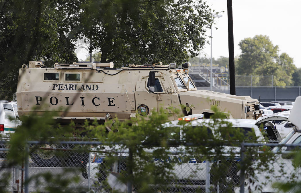 A Pearland Police armored vehicle stands ready in front of Santa Fe High School in Santa Fe, Texas, in response to a shooting on Friday morning, May 18, 2018. (Kevin M. Cox/The Galveston County Da ...