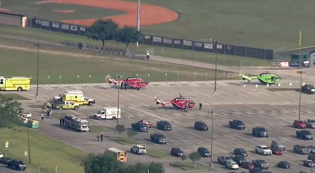 In this image taken from video helicopters sit in the parking lot of Santa Fe High School as law enforcement officers respond to the school near Houston after an active shooter was reported on cam ...