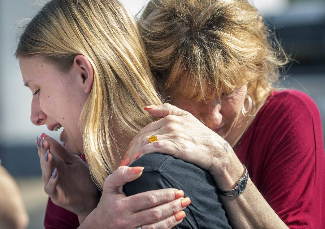 Santa Fe High School student Dakota Shrader is comforted by her mother Susan Davidson following a shooting at the school on Friday, May 18, 2018, in Santa Fe, Texas. Shrader said her friend was sh ...
