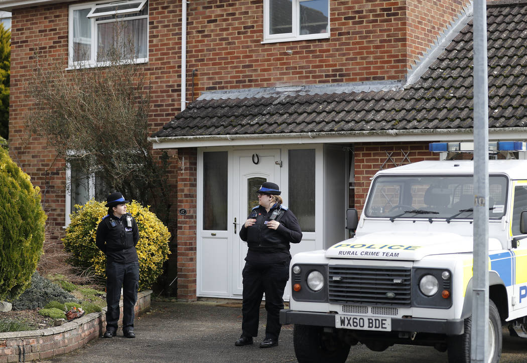 "Police officers stand outside the house of former Russian double agent Sergei Skripal who was found critically ill Sunday following exposure to an ""unknown substance"" in Salisbury, England, Tuesda ..."