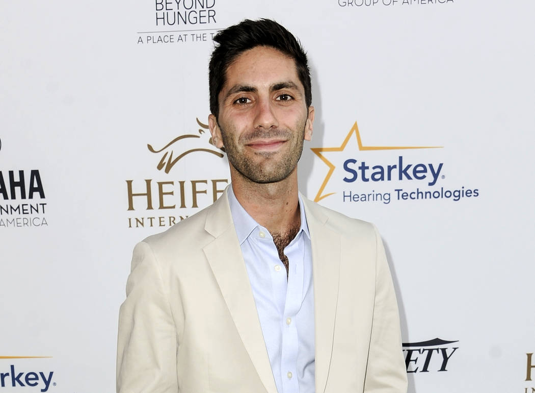"FILE - In this Aug. 22, 2014 file photo, Nev Schulman, executive producer of the MTV series ""Catfish: The TV Show,"" arrives at the 3rd Annual Beyond Hunger ""A Place At The Table&quo ..."