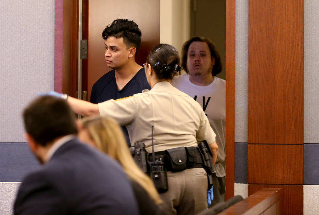 Henry Aparicio, 23, top left, who is accused in a DUI crash that killed a man and a woman, walks into the courtroom for his initial court appearance at the Regional Justice Center in Las Vegas Fri ...
