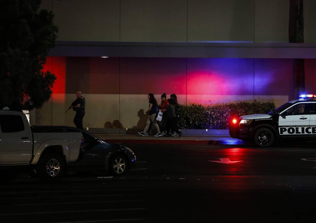 Police escort people outside of Sears at the Boulevard Mall in Las Vegas on Thursday, May 17, 2018. Andrea Cornejo Las Vegas Review-Journal @drea_cornejo
