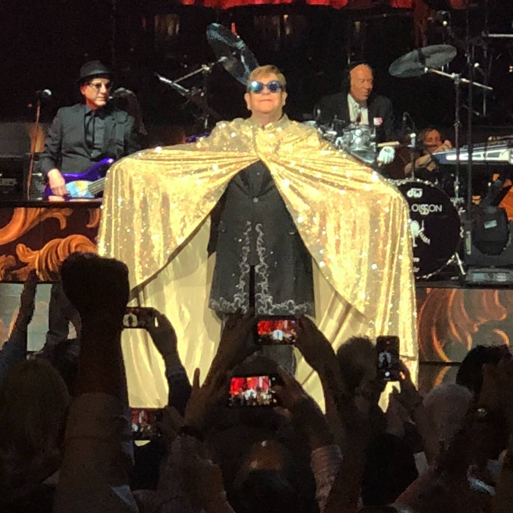 "Elton John is shows off his golden cape at the beginning of his final performance of ""Million Dollar Piano"" at the Colosseum at Caesars Palace on Thursday, May 17, 2018. (John Katsilometes/Las Veg ..."