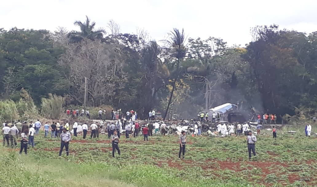 Rescue and search workers on the site where a Cuban airliner with 104 passengers on board plummeted into a yuca field just after takeoff from the international airport in Havana, Cuba, Friday, May ...