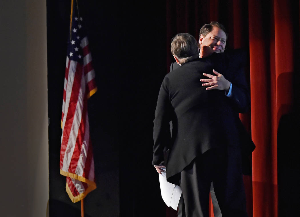 Clark County School District Superintendent Pat Skorkowsky, right, is hugged by President of the Board of Trustees Deanna Wright during his final state of the schools presentation at Legacy High S ...