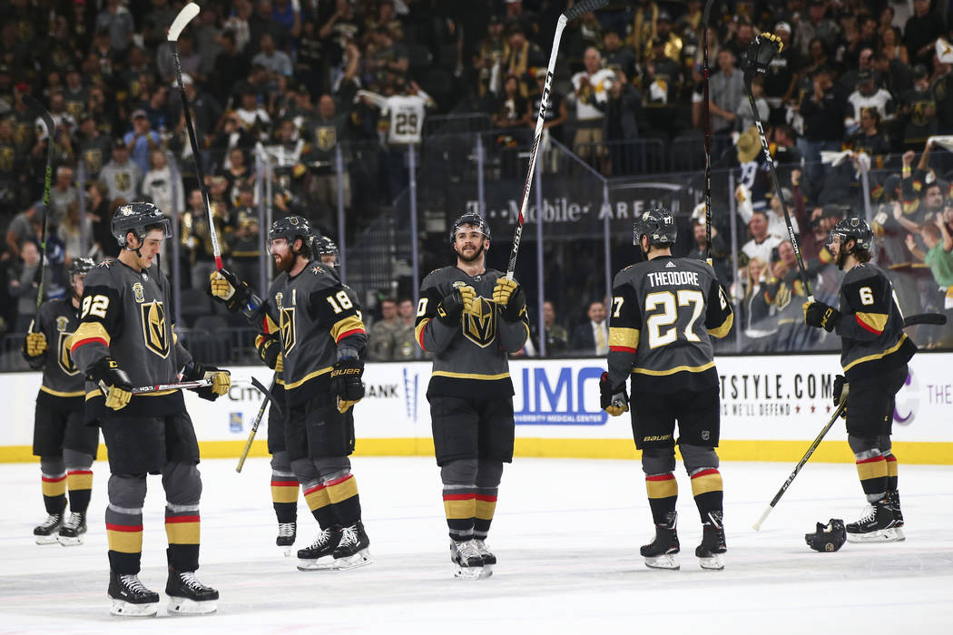 Golden Knights players celebrate their 4-2 defeat over the Winnipeg Jets in Game 3 of the NHL Western Conference finals hockey playoff series at T-Mobile Arena in Las Vegas on Wednesday, May 16, 2 ...