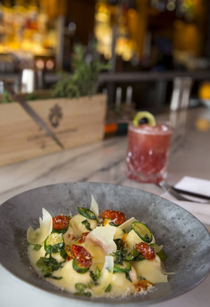 Ricotta and mascarpone cheese gnudi and primavera style vegetables served with a Toscano Sunset at Masso Osteria inside Red Rock Casino in Las Vegas on Monday, May 21, 2018. Richard Brian Las Vega ...