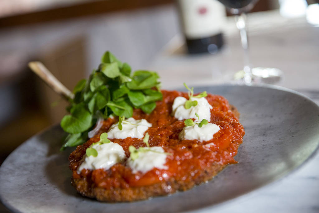 Veal chop parmigiana served with watercress, pickled onions, tomatoes and burrata cheese Masso Osteria inside Red Rock Casino in Las Vegas on Monday, May 21, 2018. Richard Brian Las Vegas Review-J ...