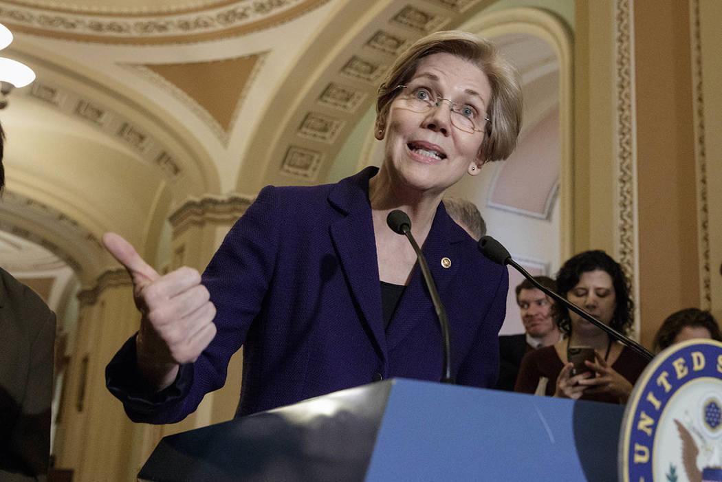 Sen. Elizabeth Warren, D-Mass., speaking with reporters at the Capitol in Washington in 2017. (AP Photo/J. Scott Applewhite)