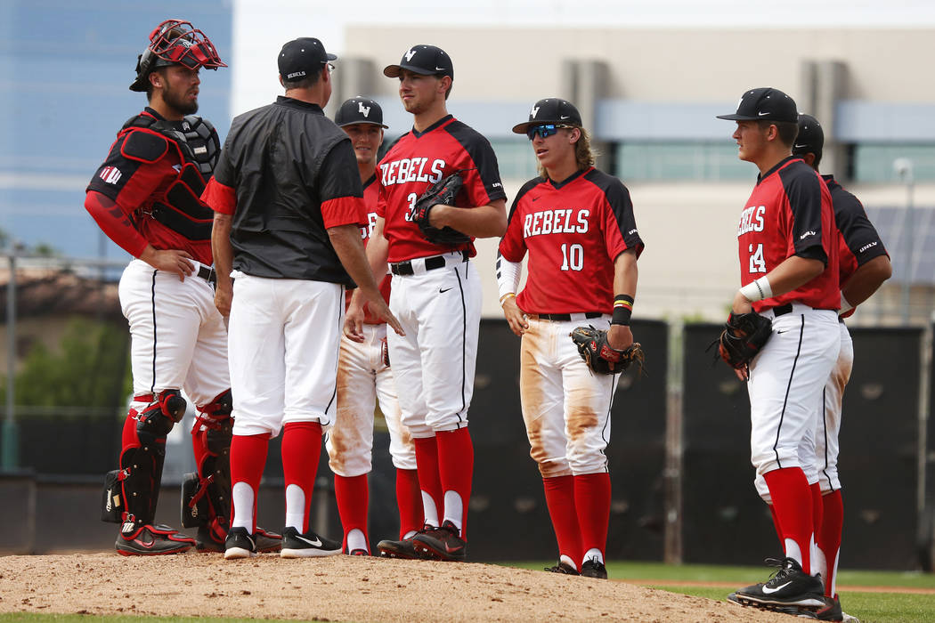 UNLV's baseball players talk during a visit to the mound against Air Force during the sixth inning at the Earl Wilson Stadium in Las Vegas on Sunday, April 15, 2018. Andrea Cornejo Las Vegas Revie ...