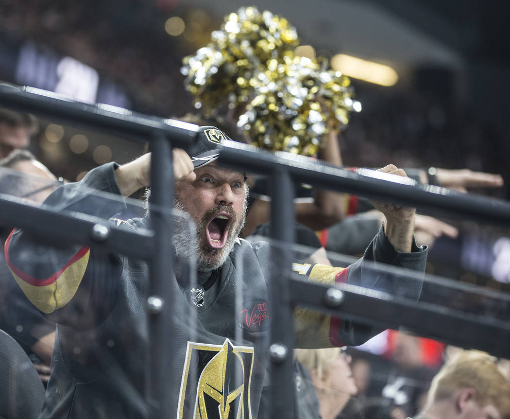 Golden Knights fans cheer for their home team during the first period of game four of Las Vegas' NHL Western Conference Finals matchup with Winnipeg on Friday, May 18, 2018, at T-Mobile Arena, in ...