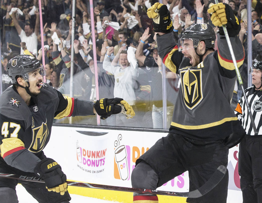 Golden Knights right wing Reilly Smith (19) celebrates with Luca Sbisa (47) after scoring a third period goal during game four of Las Vegas' NHL Western Conference Finals matchup with Winnipeg on ...