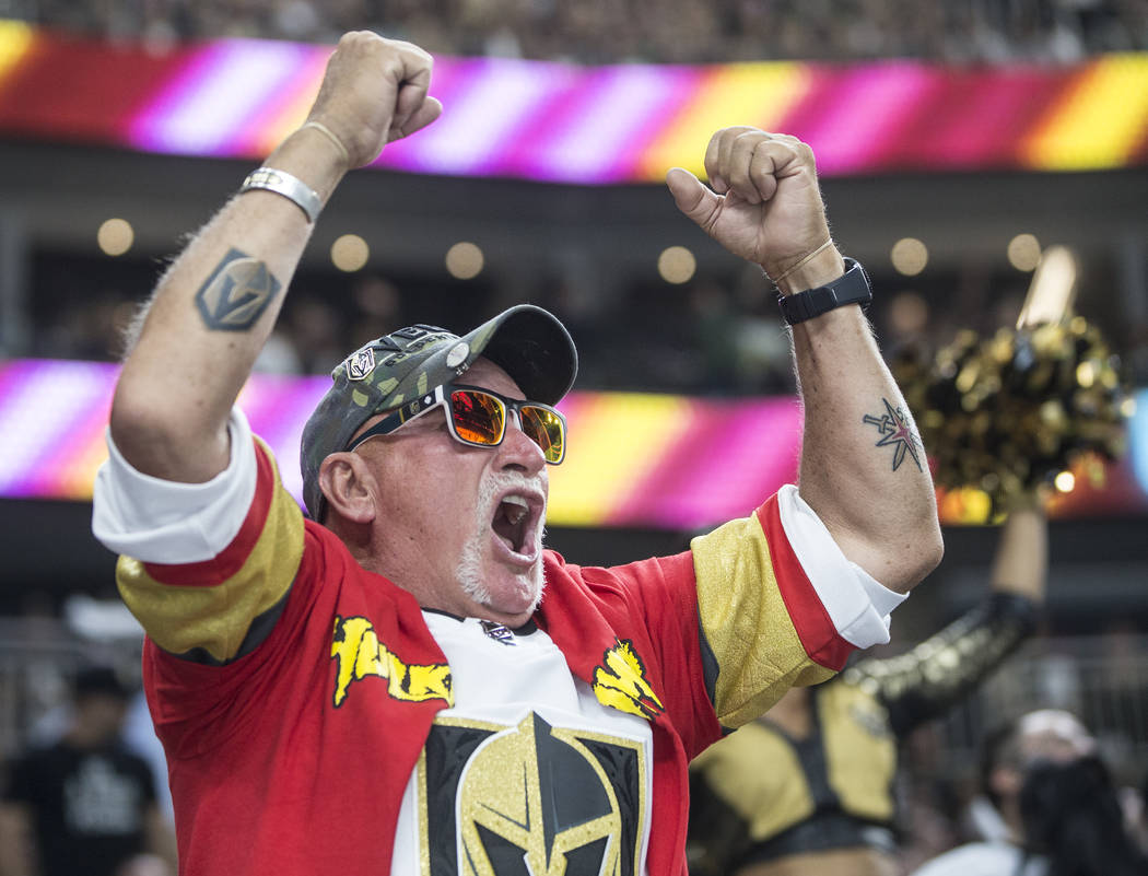 Golden Knights fans cheer for their home town team in the third period during game four of Las Vegas' NHL Western Conference Finals matchup with the Winnipeg Jets on Friday, May 18, 2018, at T-Mob ...