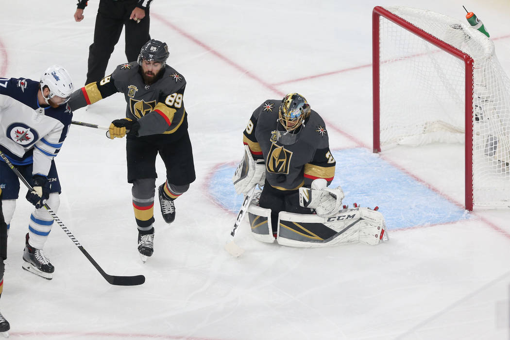 Vegas Golden Knights goaltender Marc-Andre Fleury (29) makes a stop against Winnipeg Jets during the first period in Game 4 of the Western Conference Final at T-Mobile Arena in Las Vegas, Friday, ...