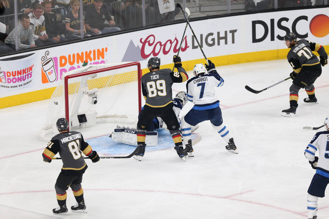 A shot by Vegas Golden Knights center William Karlsson (71) goes in for a score against Winnipeg Jets goaltender Connor Hellebuyck (37) during the first period in Game 4 of the Western Conference ...
