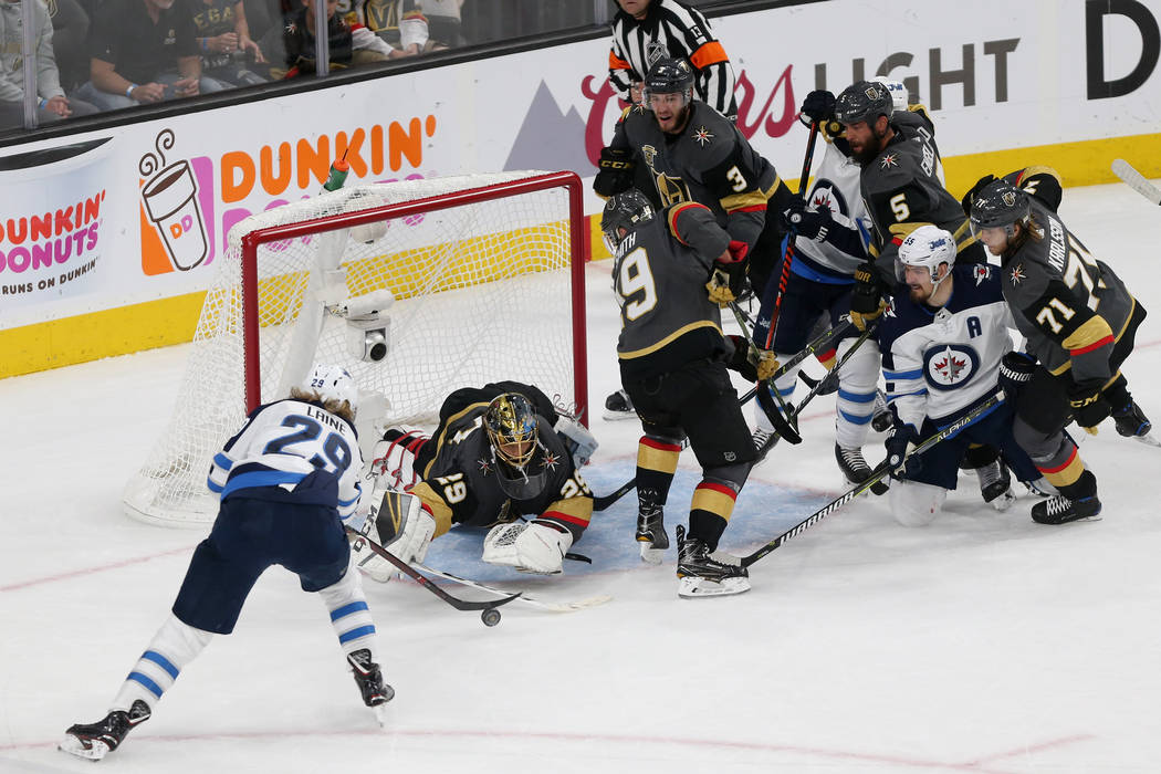 Vegas Golden Knights goaltender Marc-Andre Fleury (29) dives for a stop against Winnipeg Jets right wing Patrik Laine (29) during the second period in Game 4 of the Western Conference Final at T-M ...