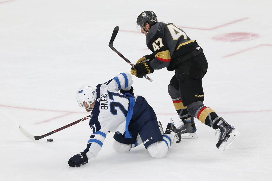 Vegas Golden Knights defenseman Luca Sbisa (47) defends against Winnipeg Jets left wing Nikolaj Ehlers (27) during the second period in Game 4 of the Western Conference Final at T-Mobile Arena in ...