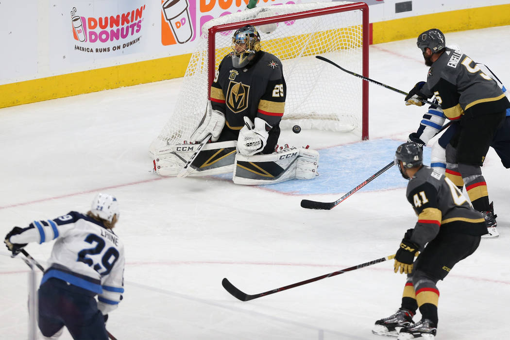 Winnipeg Jets right wing Patrik Laine (29) shoots for a score against Vegas Golden Knights goaltender Marc-Andre Fleury (29) during the second period in Game 4 of the Western Conference Final at T ...