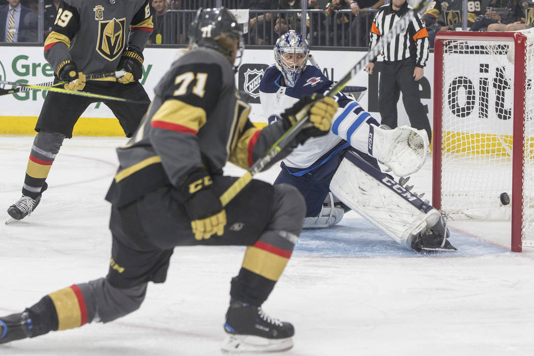 Golden Knights center William Karlsson (71) scores a first period goal against Jets goaltender Connor Hellebuyck (37) during game four of Las Vegas' NHL Western Conference Finals matchup with Winn ...
