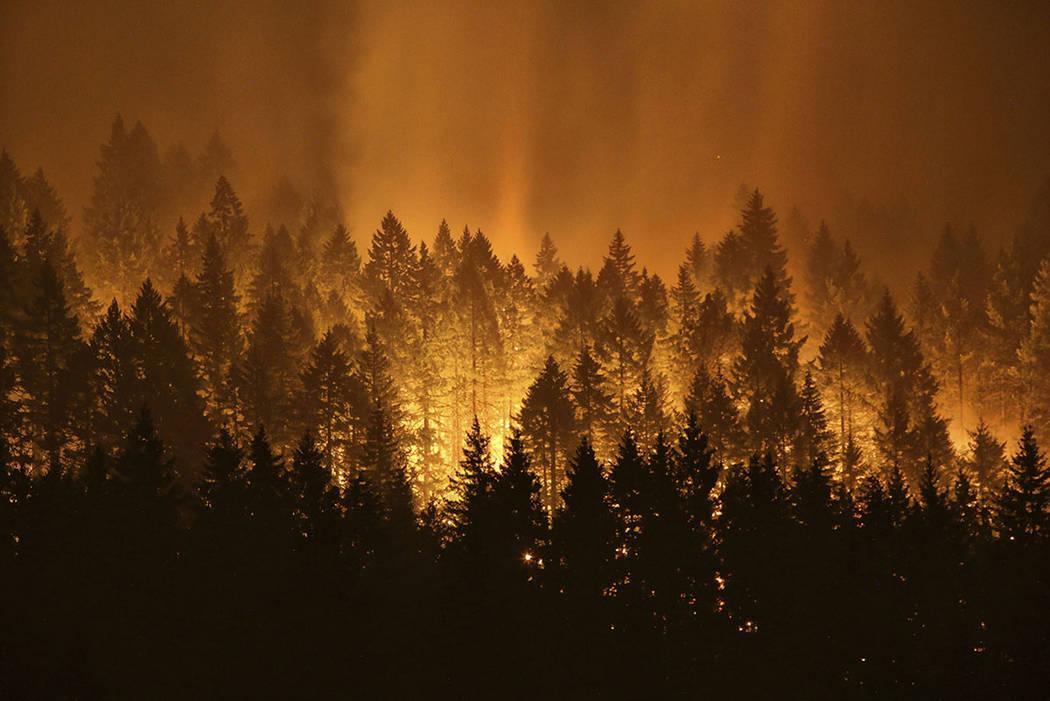 The Eagle Creek wildfire burns on the Oregon side of the Columbia River Gorge near Cascade Locks, Ore., in September 2017. (Genna Martin/seattlepi.com via AP, File)