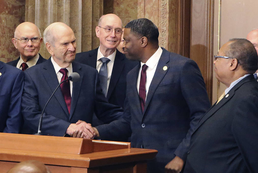 Mormon church President Russell M. Nelson shakes hands with Derrick Johnson, president of the NAACP during a news conference, in Salt Lake City on Thursday. (AP Photo/Rick Bowmer, File)