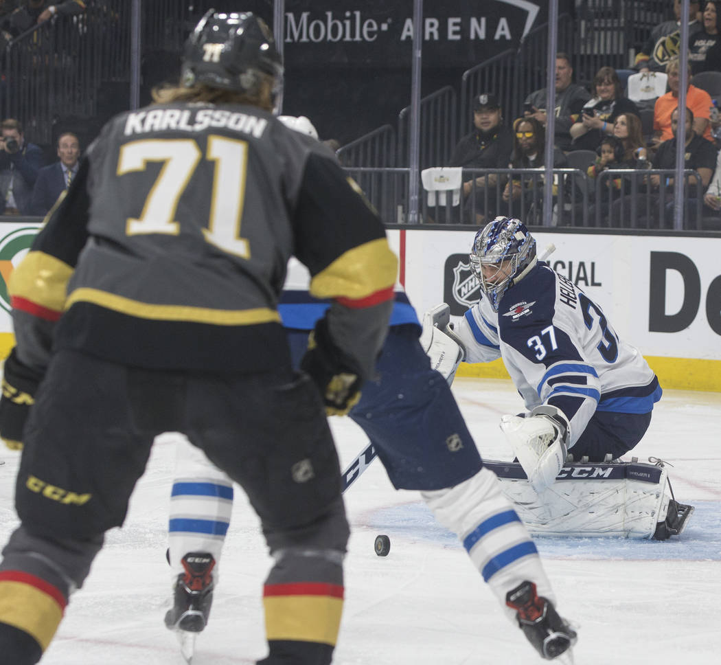 Jets goaltender Connor Hellebuyck (37) makes a save in the first period during game four of Winnipeg's NHL Western Conference Finals matchup with the Golden Knights on Friday, May 18, 2018, at T- ...