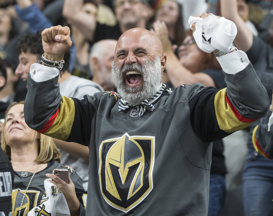 Golden Knights fans cheer during the second period of game four of Las Vegas' NHL Western Conference Finals matchup with the Winnipeg Jets on Friday, May 18, 2018, at T-Mobile Arena, in Las Vegas. ...