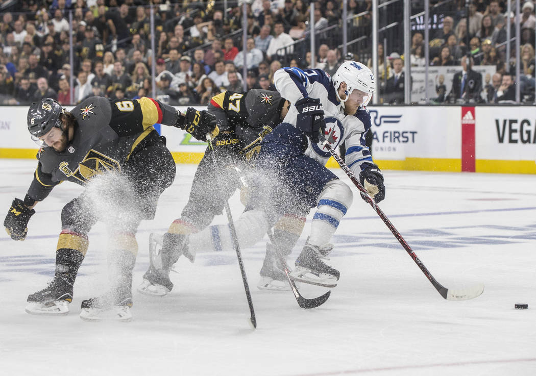 Jets left wing Nikolaj Ehlers (27) splits Golden Knights defenseman Luca Sbisa (47) and Colin Miller (6) during game four of Winnipeg's NHL Western Conference Finals matchup on Friday, May 18, 201 ...