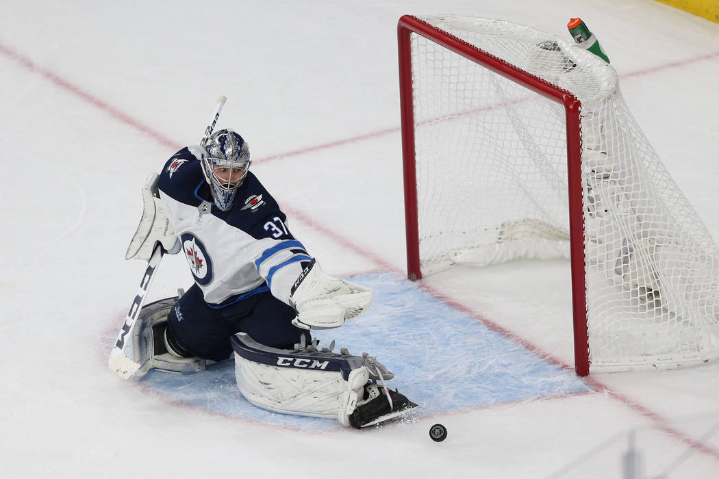 Winnipeg Jets goaltender Connor Hellebuyck (37) defends a shot against Vegas Golden Knights during the second period in Game 4 of the Western Conference Final at T-Mobile Arena in Las Vegas, Frida ...