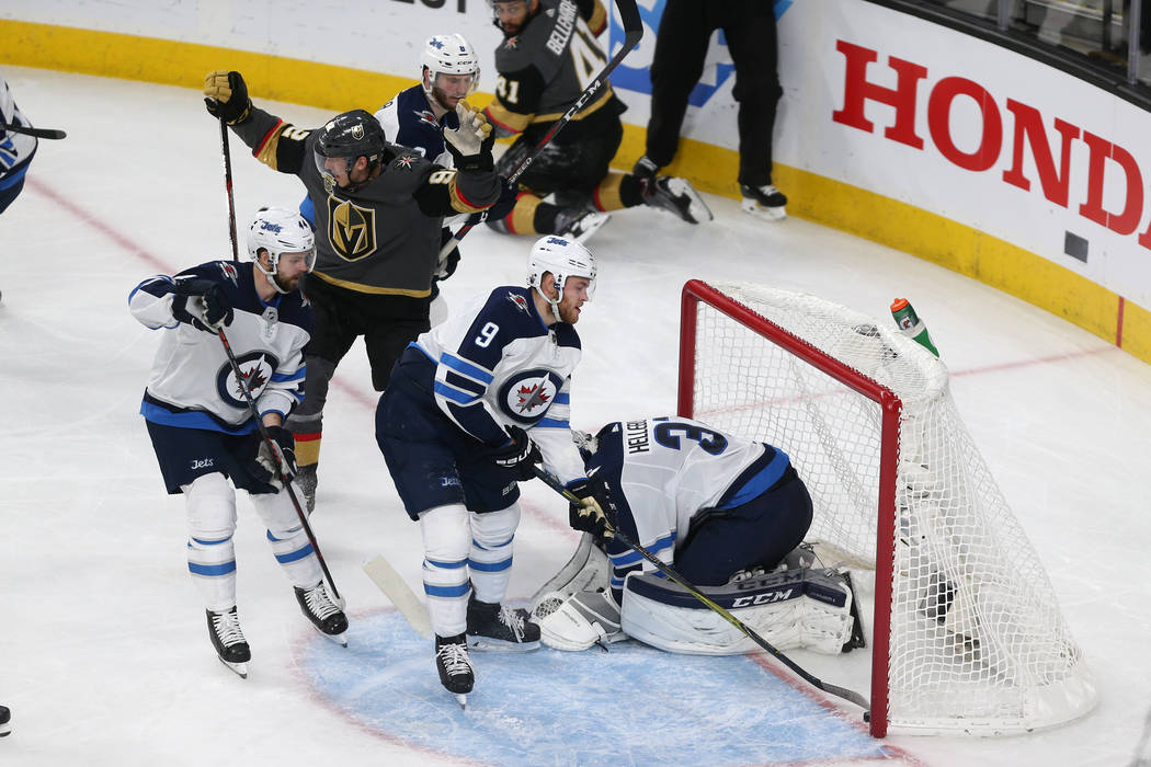Vegas Golden Knights left wing Tomas Nosek (92) reacts after a shot for a score against Winnipeg Jets goaltender Connor Hellebuyck (37) during the second period in Game 4 of the Western Conference ...