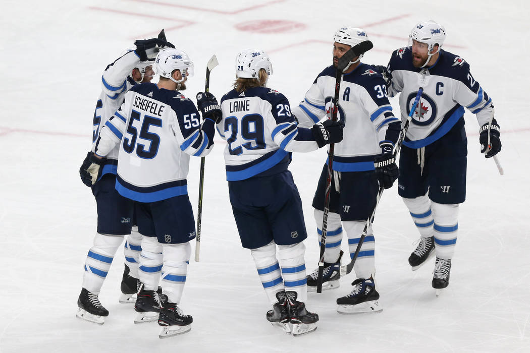Winnipeg Jets right wing Patrik Laine (29) celebrates a score with his team against the Vegas Golden Knights during the second period in Game 4 of the Western Conference Final at T-Mobile Arena in ...