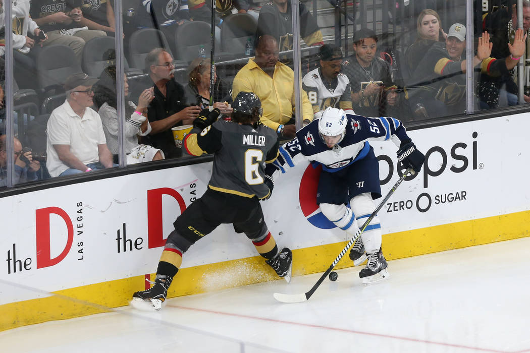 Vegas Golden Knights defenseman Colin Miller (6) defends against Winnipeg Jets center Jack Roslovic (52) during the second period in Game 4 of the Western Conference Final at T-Mobile Arena in Las ...