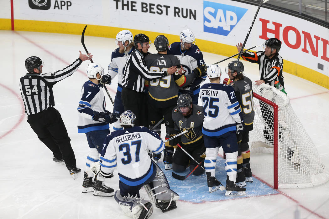 A scuffle breaks after a play by the Vegas Golden Knights against the Winnipeg Jets during the second period in Game 4 of the Western Conference Final at T-Mobile Arena in Las Vegas, Friday, May 1 ...